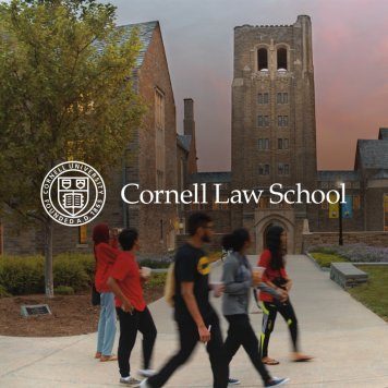Cornell Law students walking on campus at dusk